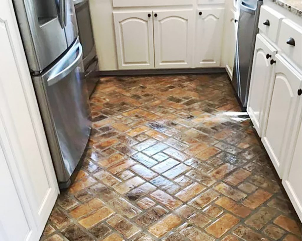 Pinwheel pattern on a floor in the Abbeville brick color.