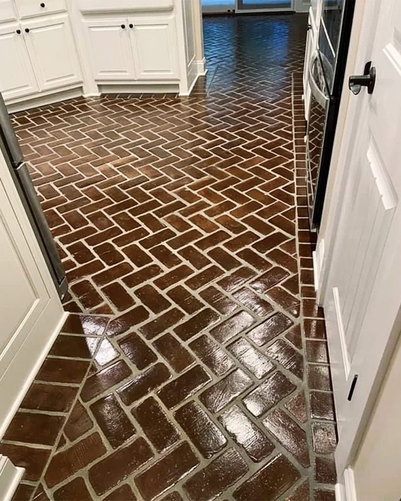 Herringbone pattern on a floor with Soldier Course borders in Baton Rouge brick color.