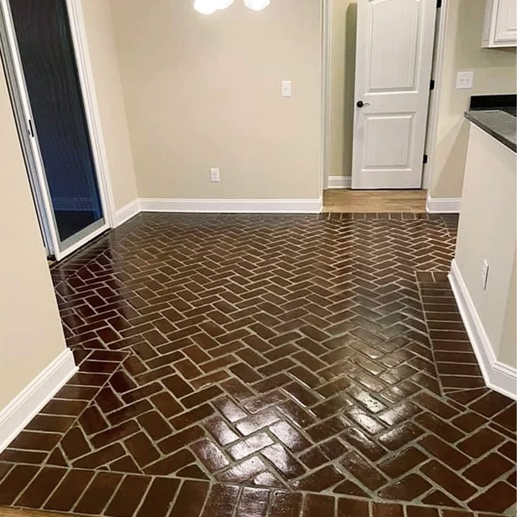 Herringbone pattern on a floor with Soldier Course borders in the Baton Rouge brick color.