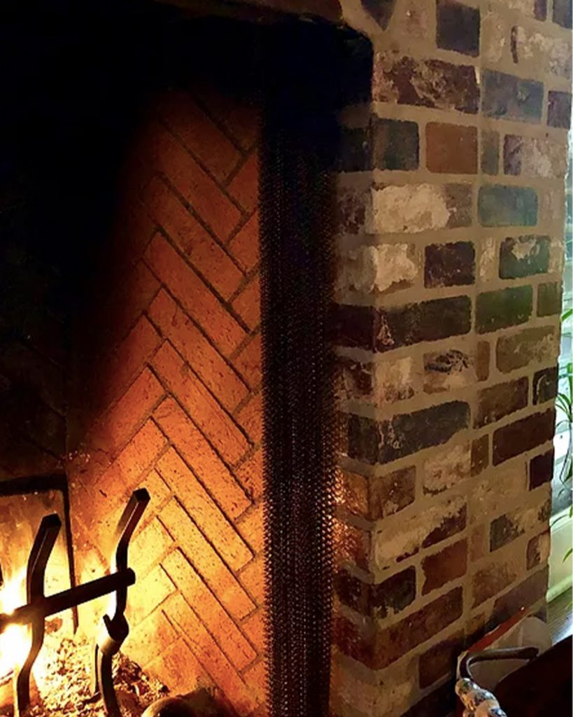 Face Brick pattern interior fireplace surround Wall in the Rose Hill color.
