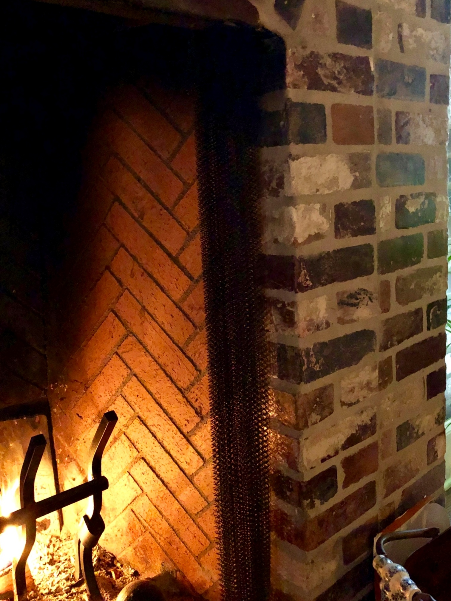 Brick fireplace surround made from PortStone Thin Brick Rose Hill color
