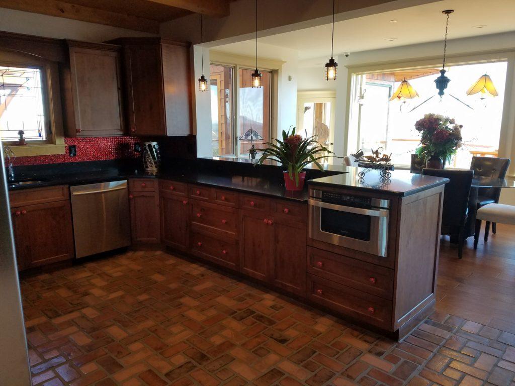Pinwheel Brick pattern. Richmond brick color. PortStone Thin Brick.  Brick floor in a kitchen.